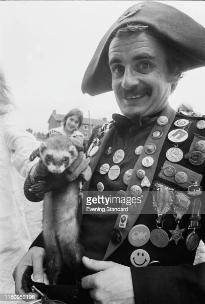 scottish-actor-sylvester-mccoy-wearing-a-period-costume-with-a-ferret-picture-id1150952198
