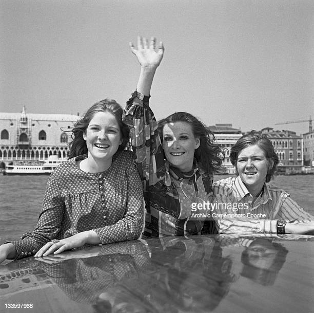 Scottish actress Adrienne Corri on a water taxi with her daugther Sarah and her son Patrick St Mark Square in the background Venice 1972