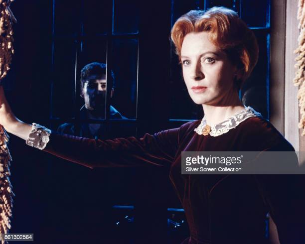 Scottish actress Deborah Kerr behind a rainsplattered window in a scene from 'The Innocents' England 1961 Lurking in the shadows behind her is...