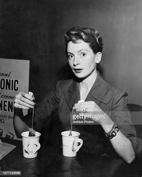 Scottish actress Deborah Kerr makes tea for two during rehearsals for the ABC Screen Guild Theater production of 'Brief Encounter' January 1951 She...