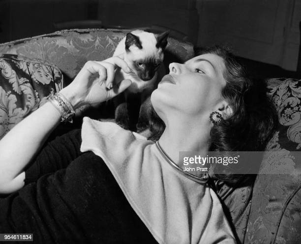 Scottish actress Elizabeth Sellars with her pet Siamese cat at her home in Bayswater London 1952