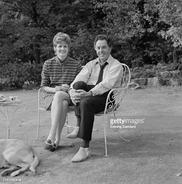 Scottish actress Elspet Gray and English actor and activist Brian Rix sitting in a back garden UK 15th October 1969