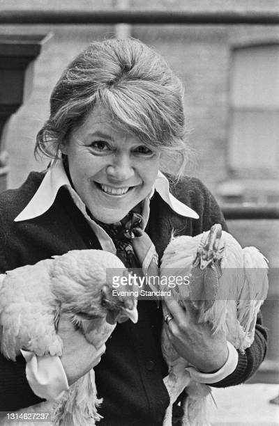 Scottish actress Pat Heywood with two chickens, UK, 29th April 1974.