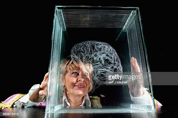 Scottish artist Angela Palmer poses for a picture beside her sculpture at the Scottish National Portrait Gallery on January 30 2014 in Edinburgh...