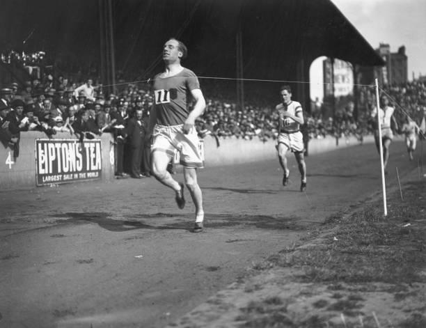 Scottish athlete Eric Liddell winning the 440 yards race at the Amateur Athletics Association championships at Stamford Bridge London UK Eric Liddell...
