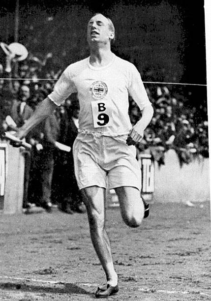 Scottish athlete Eric Liddell wins the 1mile relay at an International Athletics Meeting between England and America at Stamford Bridge London UK...