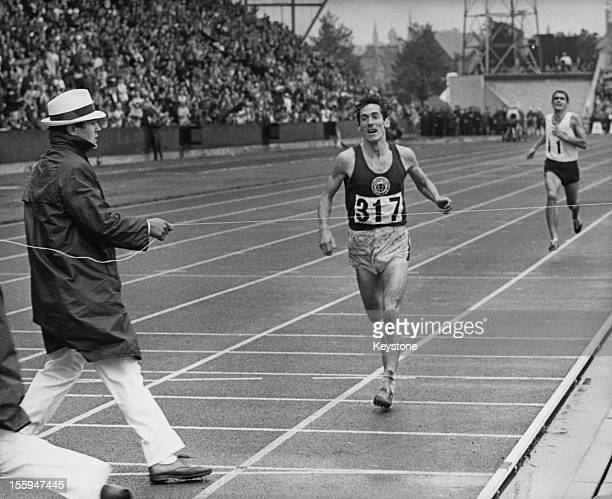 Scottish athlete Lachie Stewart wins the 10000 Metres at the British Commonwealth Games in Edinburgh with Australia's Ron Clarke finishing second...