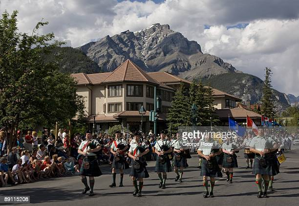 Scottish bagpipe band marches down Banff Avenue with Cascade Mountain as a backdrop during the Canada Day parade in this 2009 Banff Springs Canada...