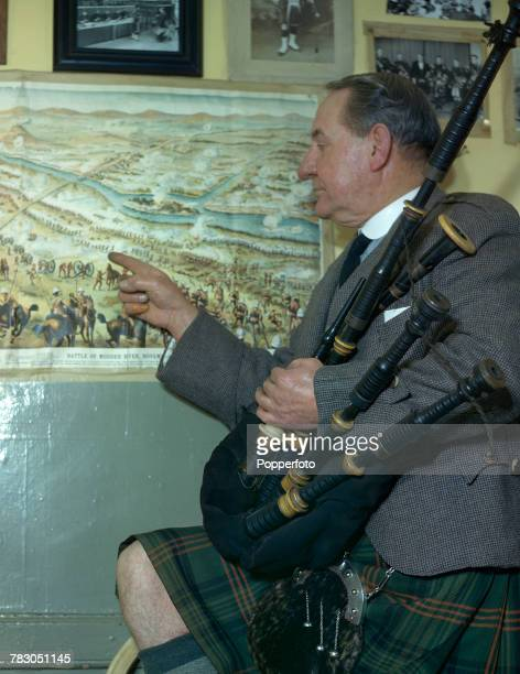 Scottish bagpipe player Willie Ross principal instructor at the Army School of Bagpipe Music and Highland Drumming pictured with his bagpipes as he...