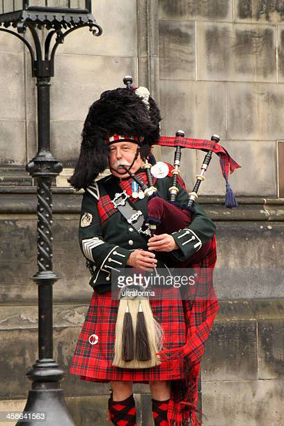 scottish bagpiper - piper stock photos and pictures