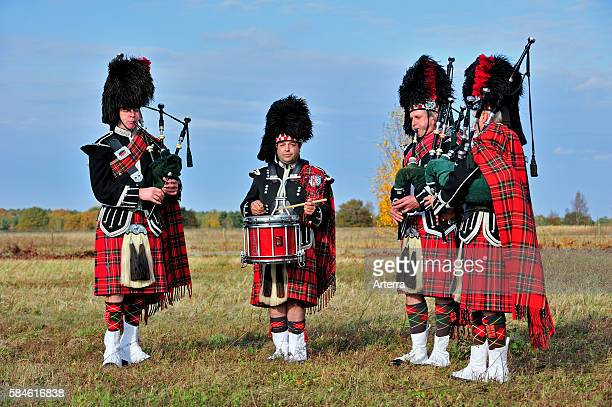 Scottish bagpipers playing pipes and drums Scotland UK