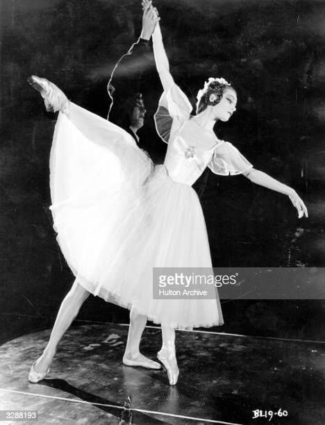 Scottish ballerina Moira Shearer born Moira King dances the part of Stella with Edmund Audran in a scene from the fantasy musical 'Tales of Hoffmann'...