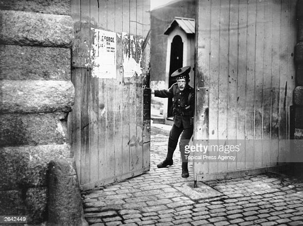 Scottish Borderer closing the entrance to the Royal Barracks, after the Bachelor's Walk Massacre in Dublin. Three were killed and thirty injured...