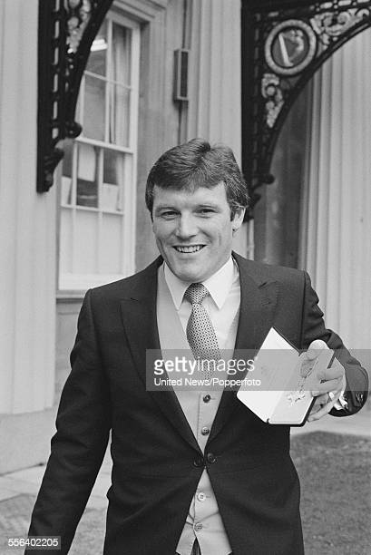 Scottish born footballer and winger/manager with Leeds United Eddie Gray pictured holding an award at an investiture ceremony at Buckingham Palace in...
