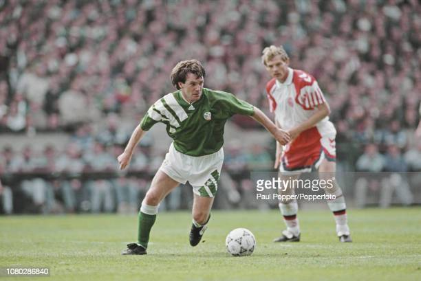 Scottish born professional footballer Ray Houghton, midfielder with Aston Villa, pictured making a run with the ball during play between the Republic...