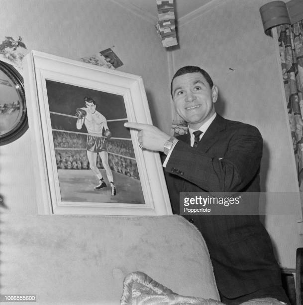 Scottish boxer and former British featherweight champion Bobby Neill pictured pointing to a portrait of himself at a residential house in Edinburgh...