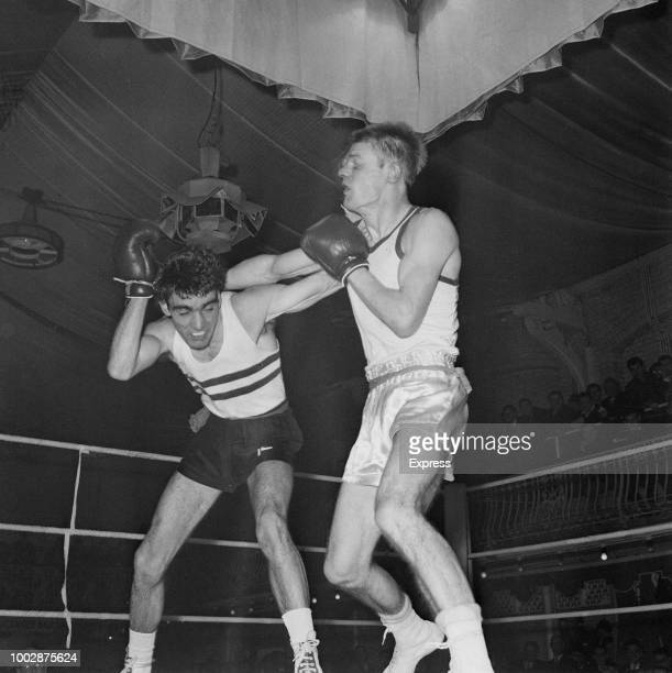 Scottish boxer Dick McTaggart pictured in action on right against Larry O'Connell to win the final of the British ABA Light welterweight championship...