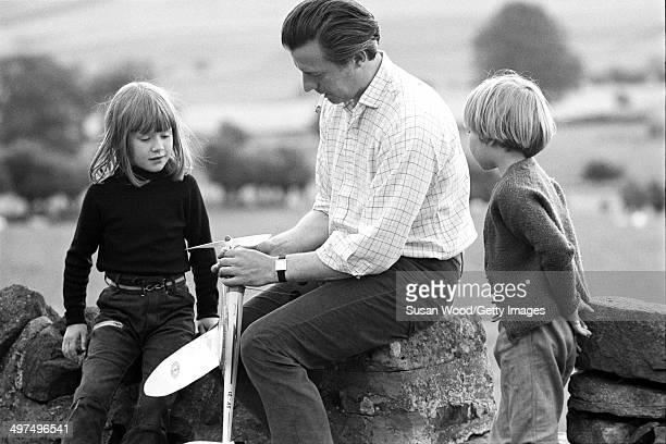 Scottish businessman and former musician Alex McEwan the sixth Laird of Bardrochat in Carrick sits on a low stone wall near his home Marchmont House...