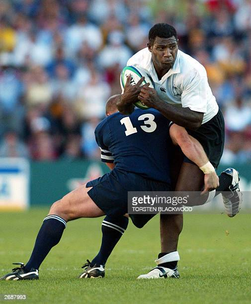 Scottish centre Gregor Townsend tackles Fijian centre Seru Rabeni during their Pool B Rugby World Cup 2003 match at the Aussie Stadium in Sydney 01...