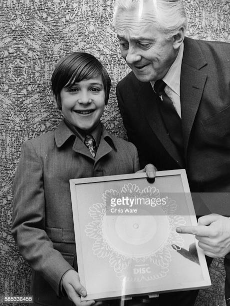 Scottish child singing star Neil Reid, whose record 'Mother of Mine' is currently at number two in the pop charts, is presented with a Silver Disc by...