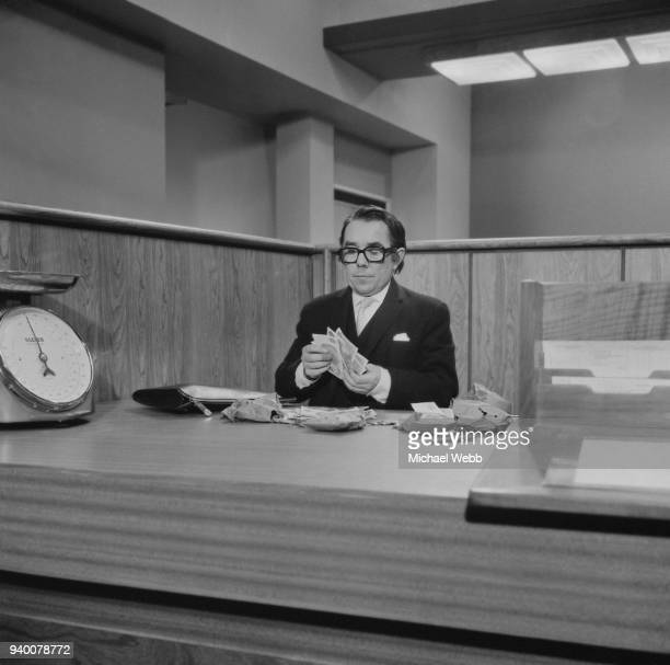 Scottish comedian Ronnie Corbett as a bank clerk during the filming of 'Some Will, Some Won't' at the Associated British studios in Elstree, UK, 1970.