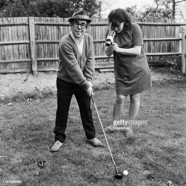 Scottish comedian Ronnie Corbett is filmed practising his golf swing by his wife Anne Hart in the garden of their house in London in March 1968.