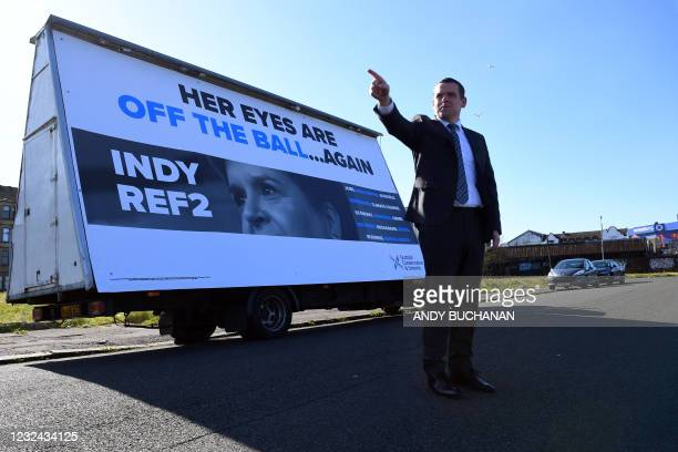 Scottish Conservative leader Douglas Ross unveils a campaign poster in Govan, Glasgow as he campaigns in the Scottish Parliamentary elections on...