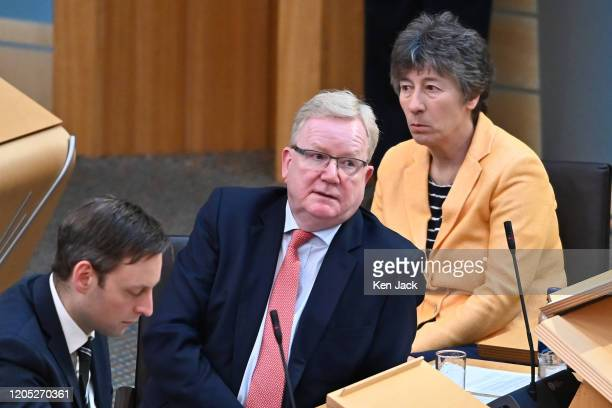 Scottish Conservative leader Jackson Carlaw during First Minister's Questions in the Scottish Parliament flanked by front bench colleagues Liam Kerr...