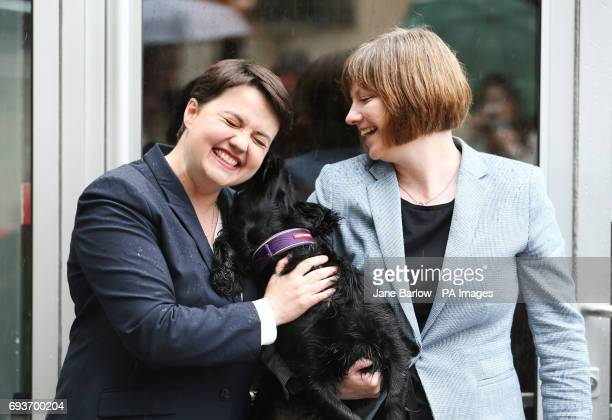 Scottish Conservative leader Ruth Davidson arrives with her partner Jen Wilson and her dog also called Wilson to cast her vote in the General...