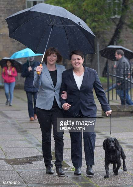 Scottish Conservative leader Ruth Davidson arrives with her partner Jen Wilson and their dog Mister Wilson at a cafe set up as a Polling Station in...