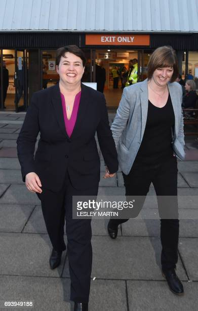 Scottish Conservative leader Ruth Davidson leaves with her partner Jen Wilson after visiting the Meadowbank Sports Centre counting centre in...