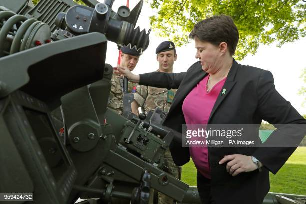 Scottish Conservative leader Ruth Davidson loads the barrel of The Royal Artillery gun with help from Sergeant Drew Campbell and gunner Jordan...