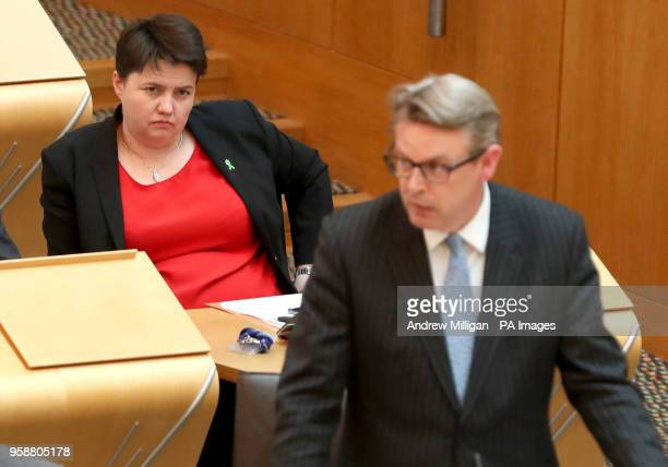 Scottish Conservative leader Ruth Davidson looks on as party spokesperson Adam Tomkins speaks during a Scottish Government debate on legislative...