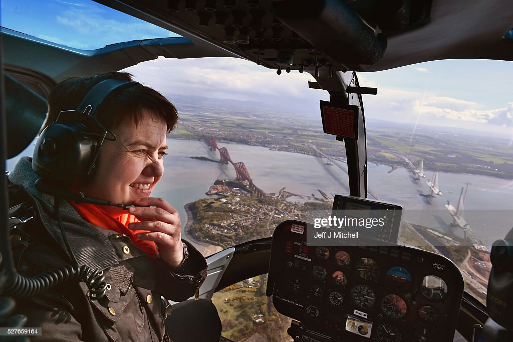 Scottish Conservative leader Ruth Davidson looks out the window at the Forth Road Bridge and Queensferry Crossing on board a helicopter during a coast-to-coast tour as campaigning continues for the Holyrood election on May 3, 2016 in North Queensferry, United Kingdom. As campaigning for the Holyrood election enters its last forty eight hours, recent polls suggest the Conservatives are virtually neck-and-neck with Labour in the race to be the main opposition party in Scotland.
