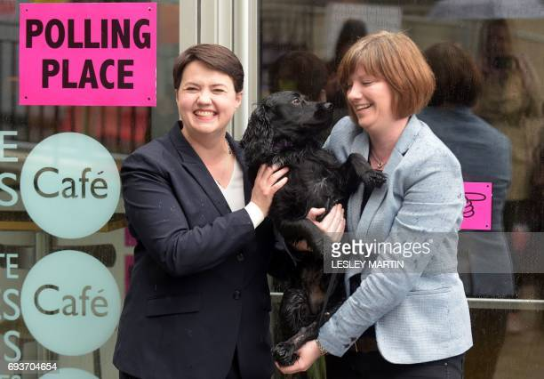 Scottish Conservative leader Ruth Davidson poses with her partner Jen Wilson and their dog Mister Wilson at a cafe set up as a Polling Station in...