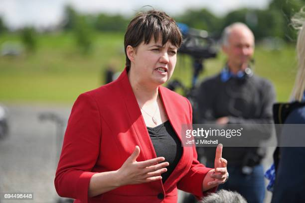 Scottish Conservative leader Ruth Davidson talks with the media following meeting with her newly elected members of parliament with the backdrop of...