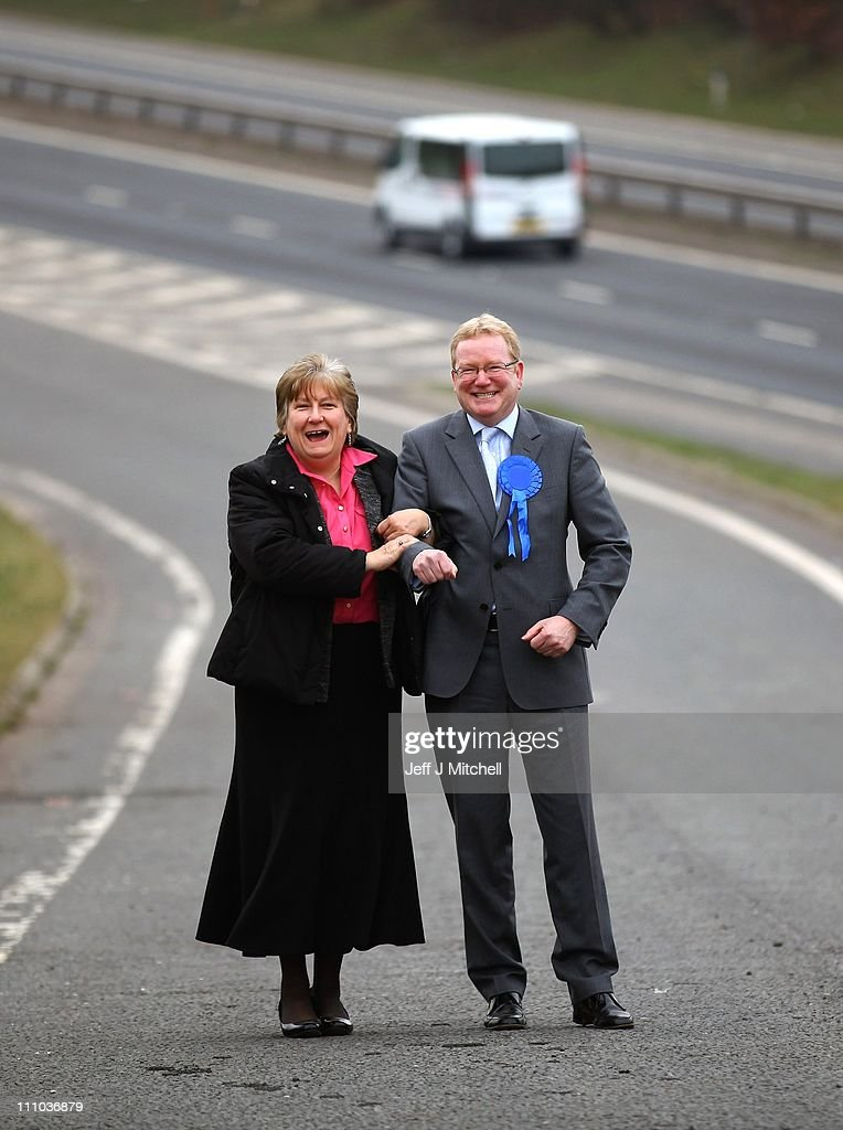 Scottish Conservative Party Leader Annabel Goldie and parliamentary candidate Jackson Carlaw (R) unveil plans for motorway shoulder programme as they stand on the flyover on the M77, North of Junction 5 near the Malletsheugh Inn on March 29, 2011 near Newton Mearns, Glasgow, Scotland. Scottish Conservatives believe that opportunities to develop appropriate sections of the hard shoulder on Scotland's motorway should be a national transport priority. The country will go to the polls in the fourth Scottish Parliament general election on Thursday May 5 to elect members.