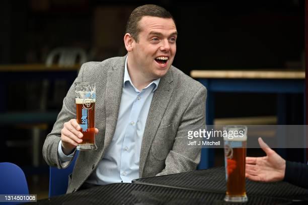 Scottish Conservative Party leader Douglas Ross enjoys a pint with local candidate Scott Douglas on April 26, 2021 in Edinburgh, Scotland. Scottish...