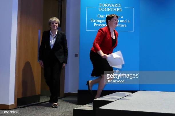 Scottish Conservative Party leader Ruth Davidson and British Prime Minister Theresa May arrive to deliver the Scottish manifesto on May 19 2017 in...