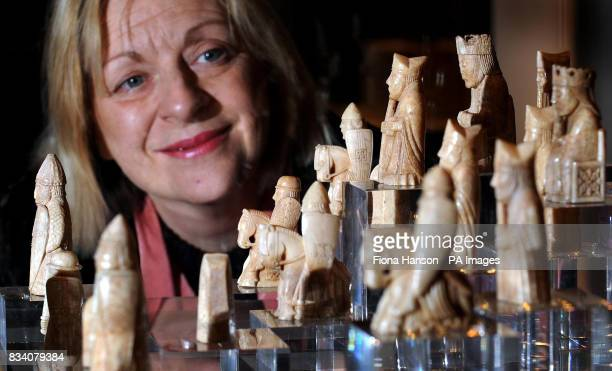 Scottish Culture Minister Linda Fabiani looks at the Lewis Chessmen, a set of 13th century figurines made from walrus ivory, at the British Museum in...