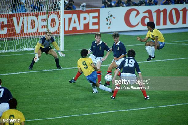 Scottish defenders surround Brazil's Antonio Careca as he threatens the goal during a 1990 World Cup match