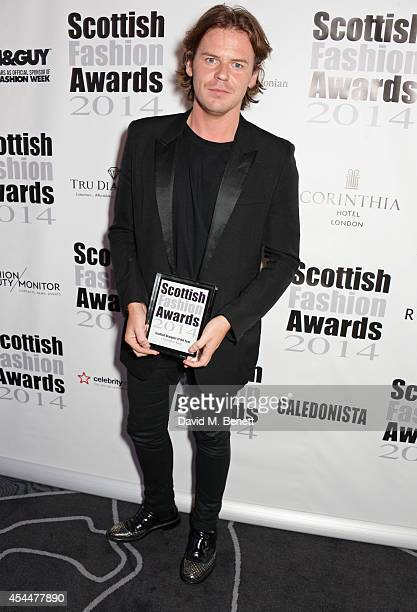 Scottish Designer of the Year Christopher Kane poses after winning during the Scottish fashion invasion of London at the 9th annual Scottish Fashion...