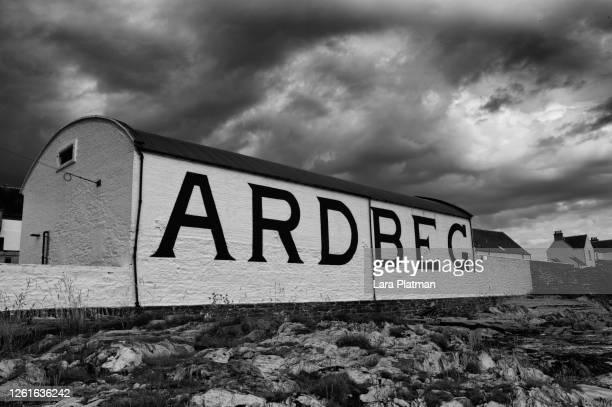 scottish distillery ardbeg - platman stock pictures, royalty-free photos & images