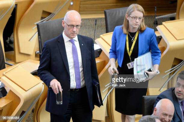 Scottish Education Secretary John Swinney and Higher Education Minister ShirleyAnne Somerville take their seats at the start of a Scottish...