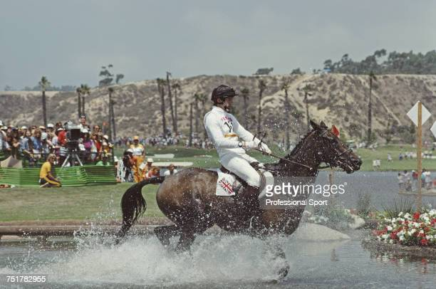Scottish equestrian Ian Stark pictured in action for the Great Britain team on his horse 'Oxford Blue' at the water hazard during competition to...