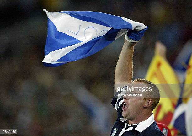 Scottish fan celebrates during the Rugby World Cup Pool B match betweenFrance and Scotland at Telstra Stadium October 25 2003 in Sydney Australia