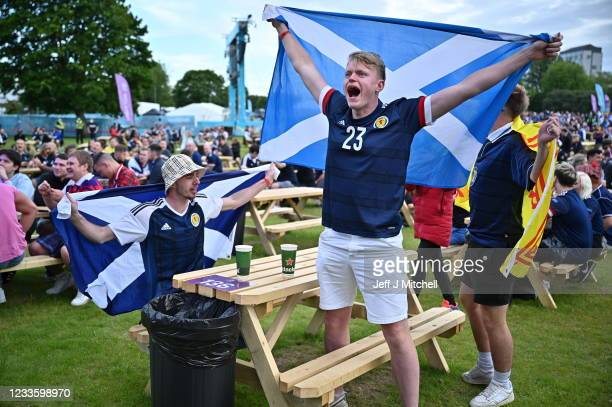 Scottish fans react as they watch the UEFA Euro 2020 Championship Group D match between Croatia and Scotland in the FanZone on June 18, 2021 in...
