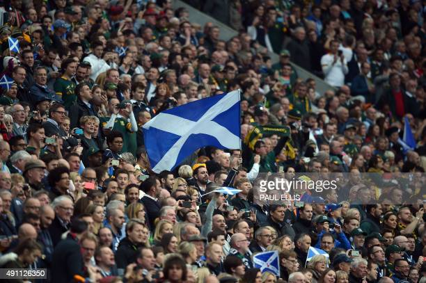 Scottish fans wave the saltire flag of Scotland during the national anthems before a Pool B match of the 2015 Rugby World Cup between South Africa...