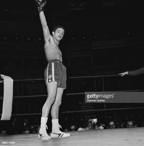 Scottish featherweight boxer Vernon Sollas celebrates in the ring after knocking out Canadian boxer Jo Jo Jackson at the Royal Albert Hall in London...