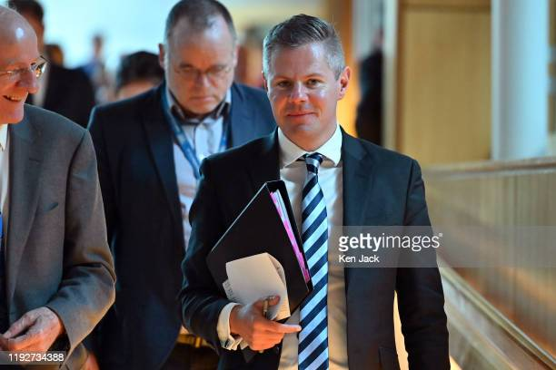 Scottish Finance Secretary Derek Mackay and MSPs leave the chamber after the first session of First Minister's Questions of the new decade in the...